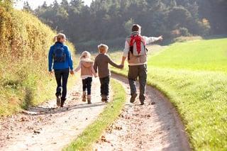 Family_walking_in_park.jpg