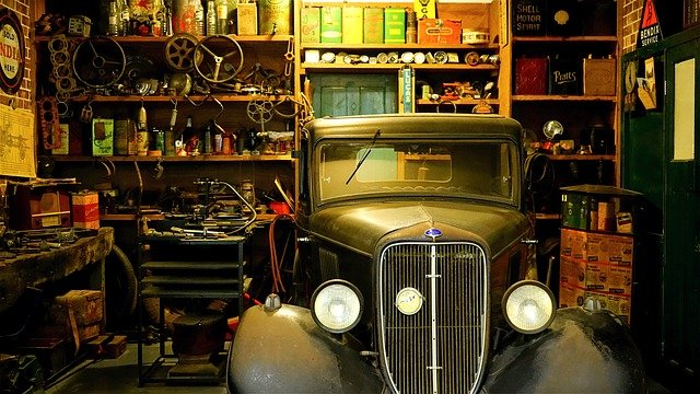 cluttered garage workshop antique vintage car